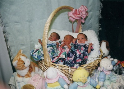 Easter 1996. 2 month old triplets. 2 pounds each. Left to right: Rachel, Emily and Lauren