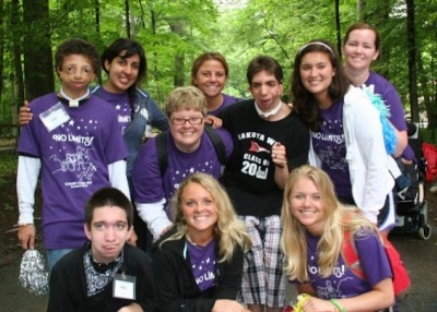 group of people with and without disabilities at camp