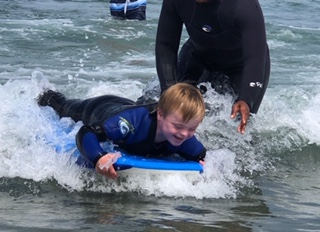 child with down syndrome surfing