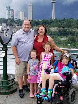mom, dad, and three kids