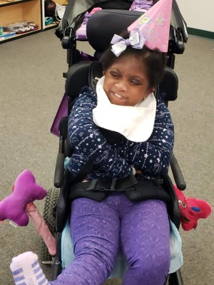young girl with a disability in a wheelchair
