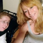 mother and son, who is in a wheelchair