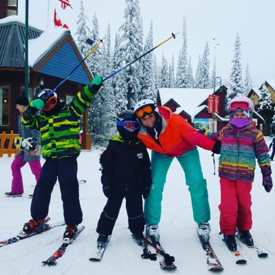 three children and mom skiing