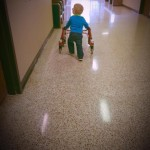 child with walker at school