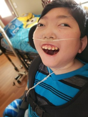 young boy in a wheelchair on oxygen