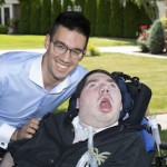 two brothers, one in wheelchair