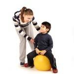 child with physical therapist