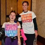 young woman in wheelchair with her mom