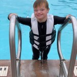 boy with Down syndrome swimming