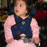 toddler in pink with feeding tube