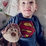 young boy with stuffed monkey