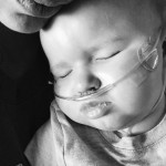 child with oxygen cannula